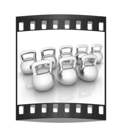 metall: Metall weights on a white background. The film strip