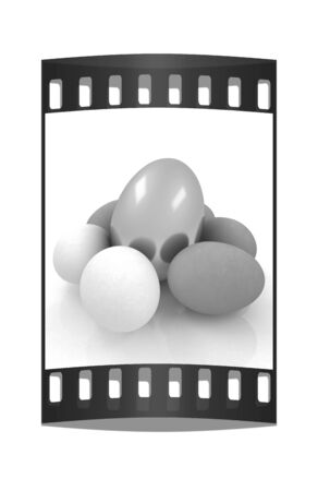 gold eggs: Eggs and gold easter egg. The film strip