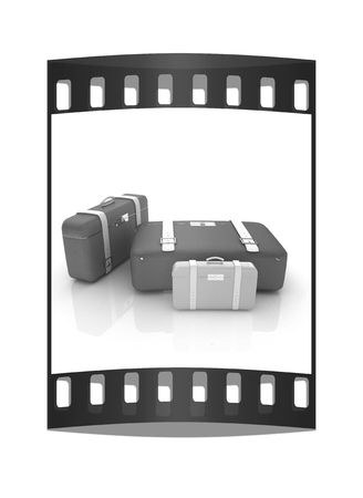 Travelers suitcases. Family travel concept. The film strip