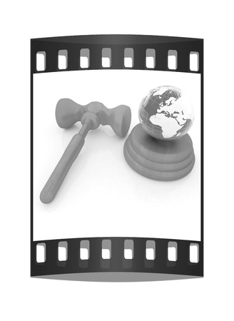 prosecutor: Wooden gavel and earth isolated on white background. Global auction concept. The film strip Stock Photo