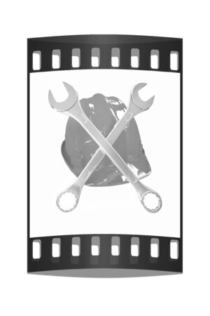 The protective helmet working and crossed wrenches. The image of a skull and bones on a white background. The film strip Reklamní fotografie - 40531559