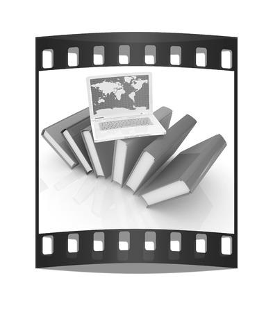 Laptop on books on a white background. The film strip photo