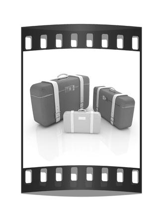 Traveler's suitcases. Family travel concept. The film strip Reklamní fotografie - 126243988