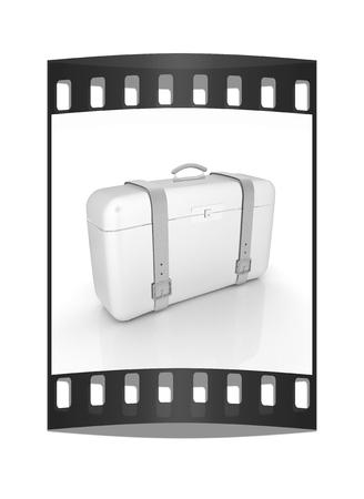 traveler's suitcase. The film strip Reklamní fotografie - 126243991