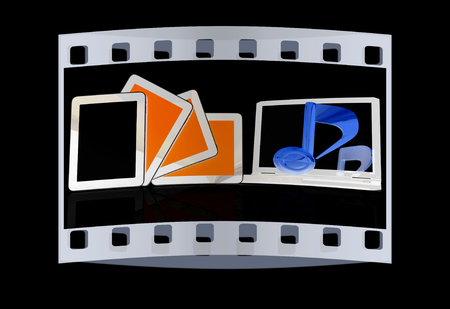 crotchets: yellow note on the  laptop and  tablet pc on a black background. The film strip