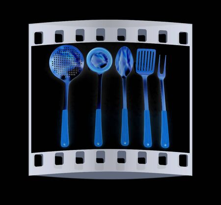 sizzle: Gold cutlery on a black background. The film strip