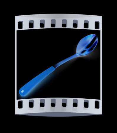sizzle: Gold long spoon on a black background. The film strip