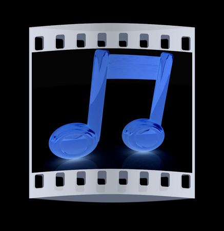 melodies: Music note on a black background. The film strip with place for your text Stock Photo