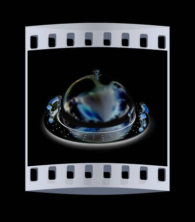 silver ware: Chrome restaurant cloche on a black background. The film strip Stock Photo