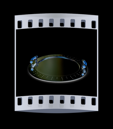 silver ware: Chrome salver on a black background. The film strip Stock Photo