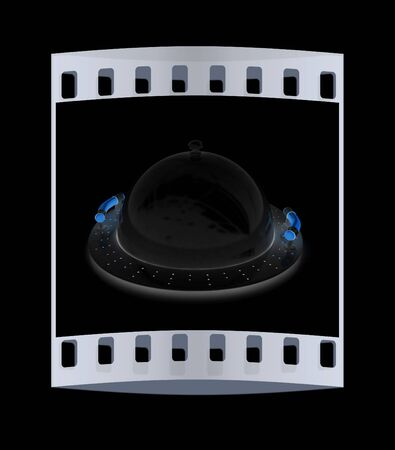 silver ware: Restaurant cloche with lid on a black background. The film strip Stock Photo
