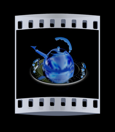 silver ware: Gold teapot on platter on a black background. The film strip