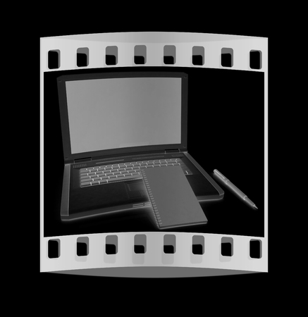powerbook: laptop and notepad on a black background. The film strip with place for your text