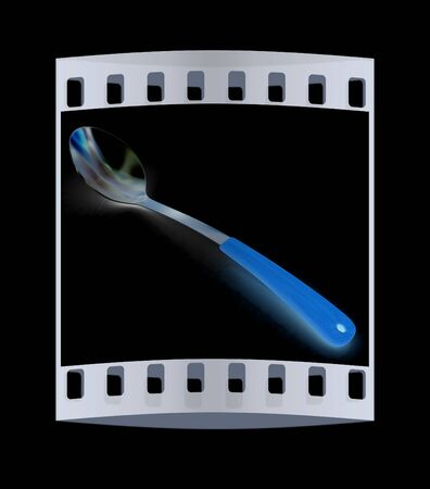 sizzle: Long spoon on a black background. The film strip