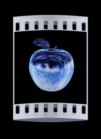gilt: Metal apple isolated on black background. The film strip