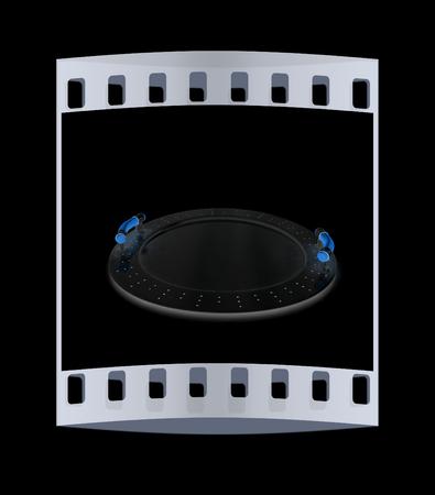 Glossy salver on a black background. The film strip