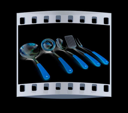 sizzle: Cutlery on a black background. The film strip
