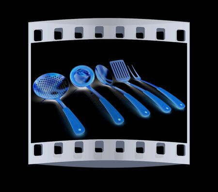 stainless steel kitchen: Gold cutlery on a black background. The film strip