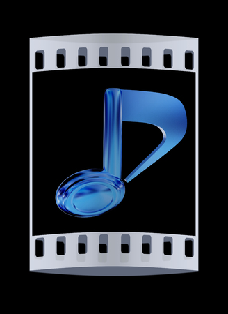 melodies: Golden note icon on a black background. The film strip Stock Photo