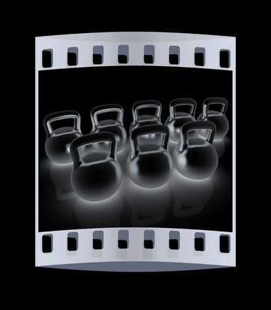 metall: Metall weights on a black background. The film strip