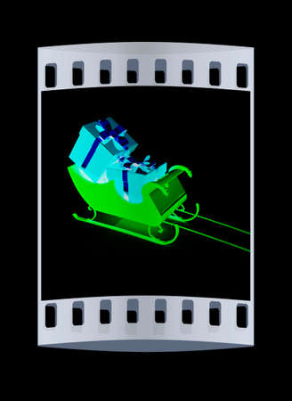 ice slide: Christmas Santa sledge with gifts on a black background. The film strip