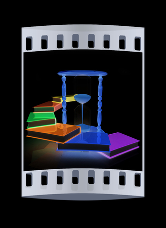 graduation countdown: Hourglass and books on a black background. The film strip Stock Photo