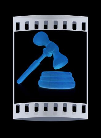 jurisdiction: Wooden gavel isolated on black background. The film strip Stock Photo