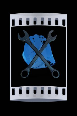 skull with crossed bones: The protective helmet working and crossed wrenches. The image of a skull and bones on a black background. The film strip