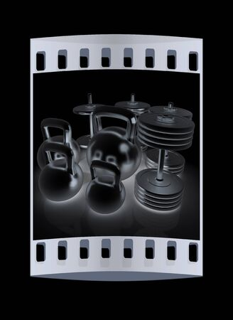 metall: Metall weights and dumbbells on a black background. The film strip