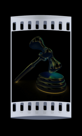 Metall gavel isolated on black background. The film strip