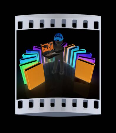 hard working man: 3d man in hard hat working at his laptop and books on a black background. The film strip Stock Photo