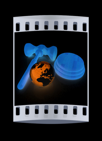 auctioning: Wooden gavel and earth isolated on black background. Global auction concept. The film strip Stock Photo
