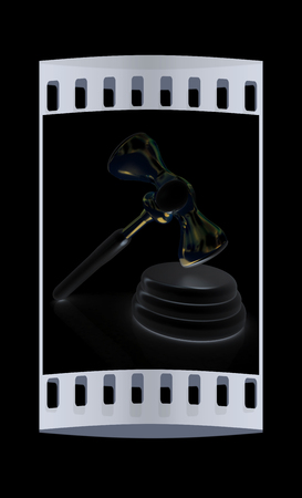 auctioning: Metall gavel isolated on black background. The film strip