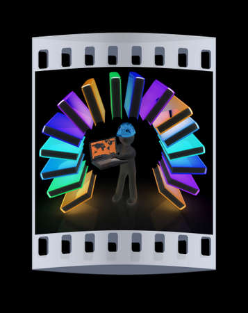 Colorful books like the rainbow and 3d man in a hard hat with laptop on a black background. The film strip