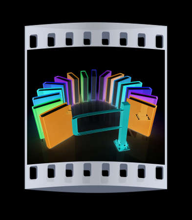 tourniquet: Colorful books in a semicircle and tourniquet to control. The concept of the exam on a black background. The film strip