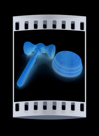 auctioning: Wooden gavel isolated on black background. The film strip Stock Photo
