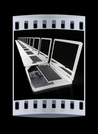 powerbook: network concept on a black background. The film strip Stock Photo