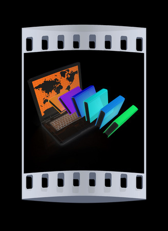 libros volando: Libros coloridos volando y portátil sobre un fondo negro. La tira de película
