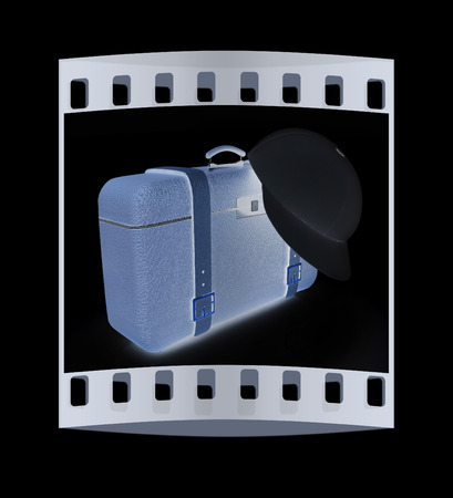 peaked cap: Brown travelers suitcase and peaked cap on a black background. The film strip Stock Photo