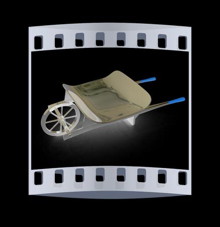 manure: metal wheelbarrow on a black background. The film strip