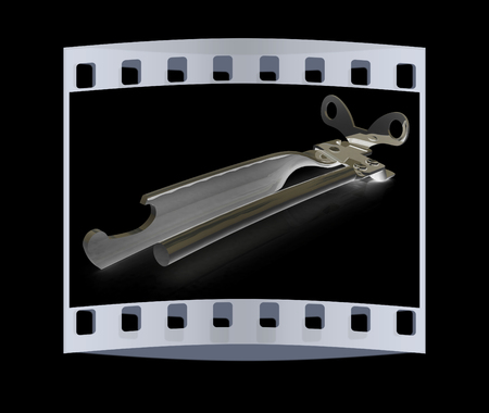 chrome base: A can opener isolated against a black background (CLIPPING PATH). The film strip