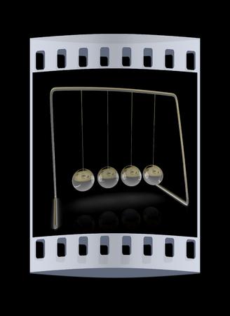 colliding: Newtons balls on black background. The film strip