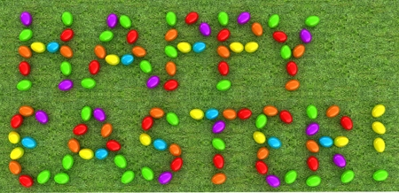 directly above: Easter eggs as a Happy Easter greeting on a green grass