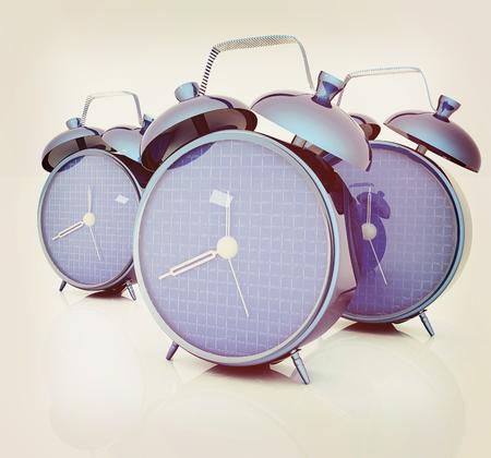 3d illustration of glossy alarm clocks against white background . 3D illustration. Vintage style.