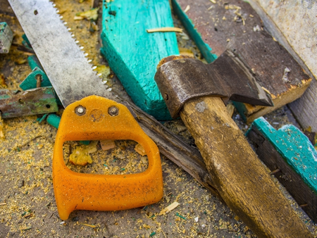 nails: Building tools: Ax and saw - close-up Stock Photo