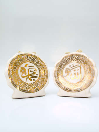mohammed: Arabic calligraphy  of Allah  Islamic God  on the right and  Prophet Muhammad transliterated as
