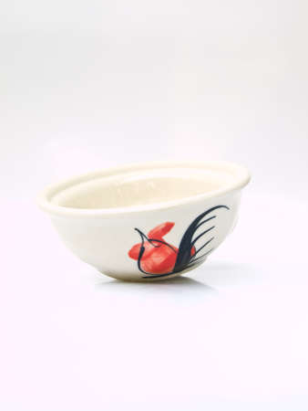 A white ceramic bowl with a chicken pattern  from Lampang, Thailand