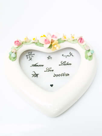 A white ceramic heart with various languages meaning of love Stock Photo - 17528439
