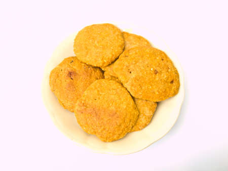 Pile of cookies on a Chiness porcelane plate Stock Photo - 17528587