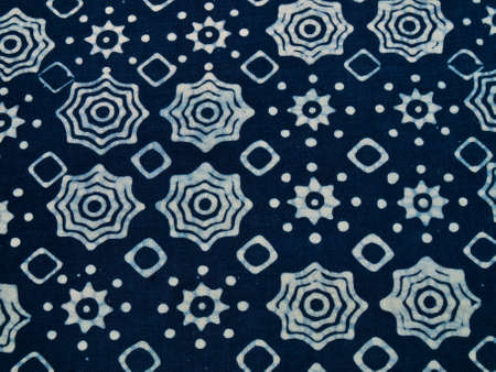 Blue batik fabric with repettition pattern as background from Yogyakarta, Indonesia Stock Photo